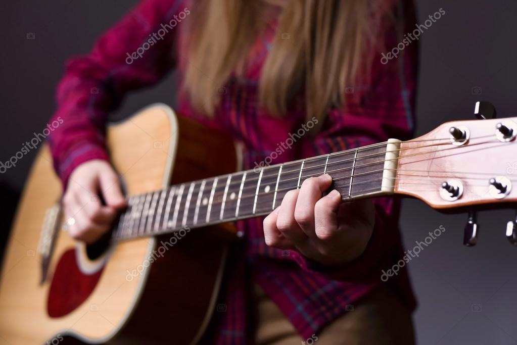 woman\'s hands playing acoustic guitar, close up. Playing acoustic ...