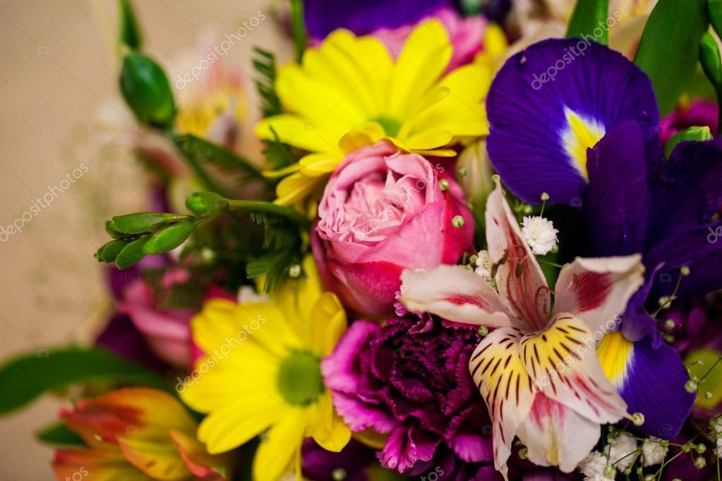Beautiful bouquet of bright flowers in basket