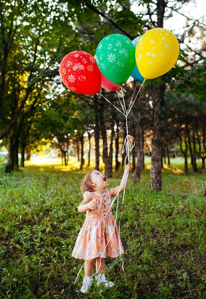 Baby Girl 2 3 Year Old Holding Balloons Outdoors Birthday Party Stock Image