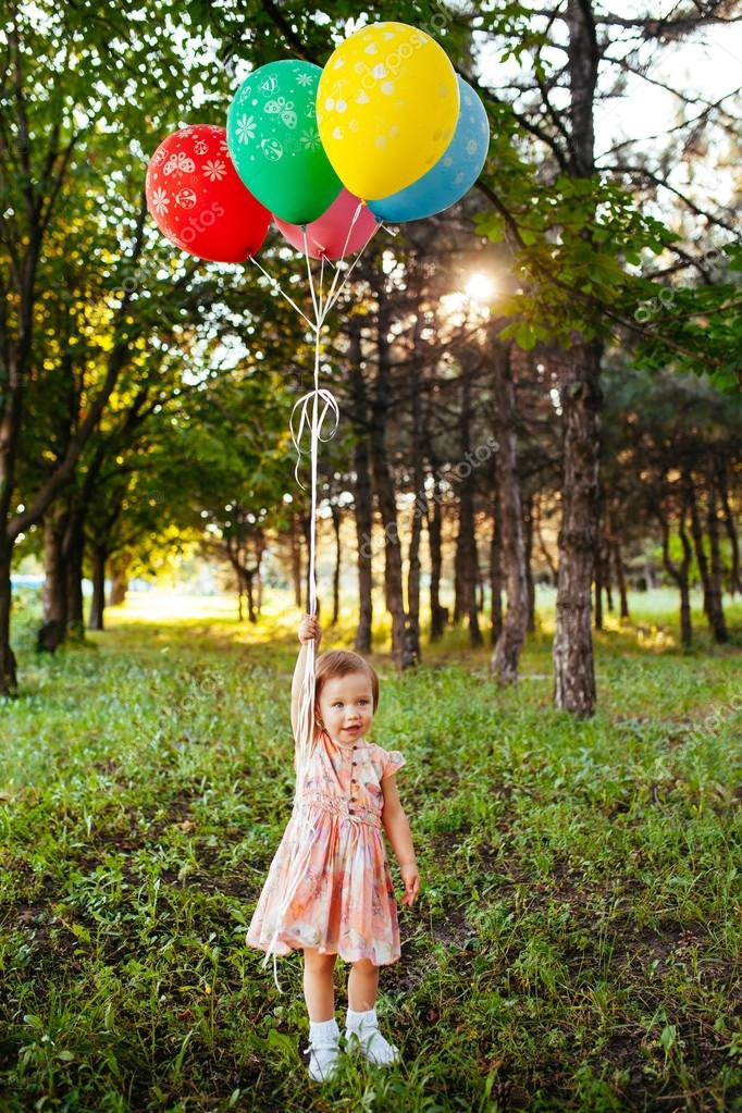 Baby Girl 2 3 Year Old Holding Balloons Outdoors Birthday Party Stock Photo