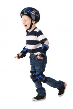 Little boy in protection helmet and in the knee and arm ruffles