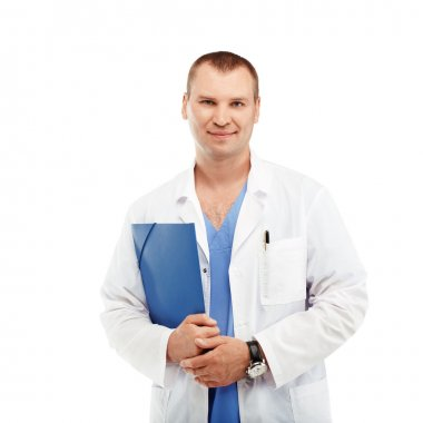 Portrait of a young male doctor in a white coat and blue scrubs