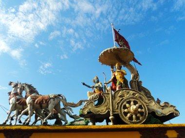 Lord Krishna preaching Bhagavadgita to Arjuna at battlefield in Kurukshetra