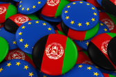 Fotografie Afghanistan and Europe Badges Background - Pile of Afghan and European Flag Buttons 3D Illustration