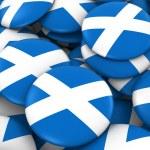 Scotland Badges Background - Pile of Scottish Flag Buttons 3D Illustration Лицензионные Стоковые Фото