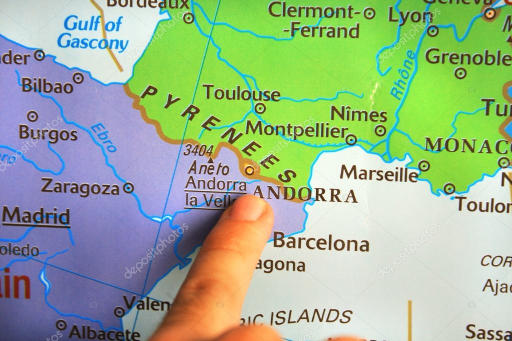 Map Of France Spain.Kid Showing France Spain Border On The Map Stock Photo