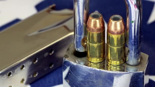 Ammunition and padlock on United States flag - Gun rights and gun control concept