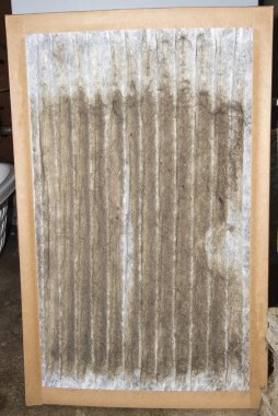 Front View Of A Dirty Furnace Filter