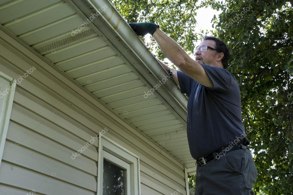 Cleaning Gutters On A Residential Home