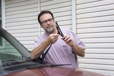 Mechanic Putting New Wiper Blade On Truck