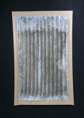 Dirty Furnace Filter On Black Background