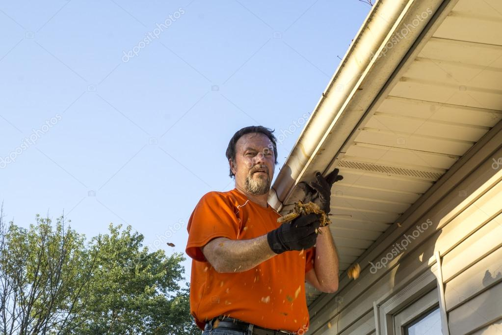 Cleaning Gutters On A Hot Day