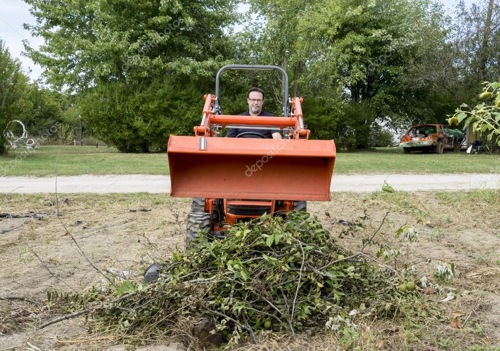 Tree Trimmer Dumping Load Of Tree Limbs