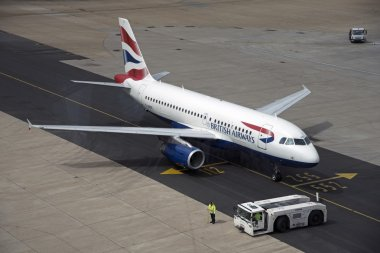 Passenger jet using new tarmac taxiway at London Gatwick Airport UK