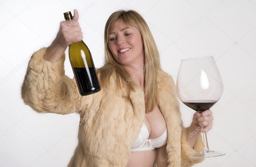 Sexy woman holding bottle of wine — photo 6