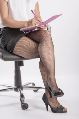Woman's legs and notebook