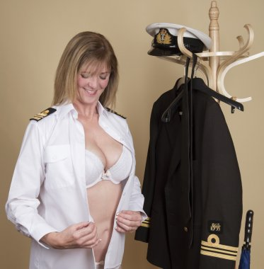 Female naval officer getting dressed into her uniform