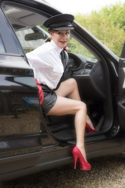 Woman chauffeur exiting her car