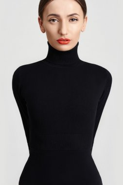 Closeup beauty portrait of a model girl in a black roll neck jumper. Sensual woman with red lips stock vector