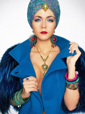 rich beautiful woman in fur and jewelry.