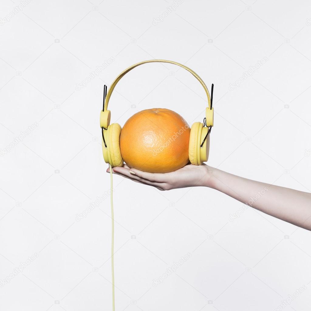 Yellow headphones on the orange