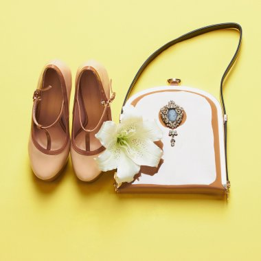 woman shoes with handbag and flower