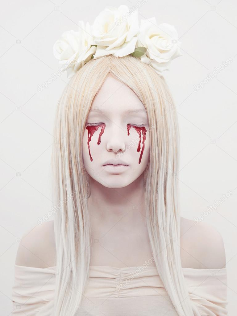 beautiful young woman with blood