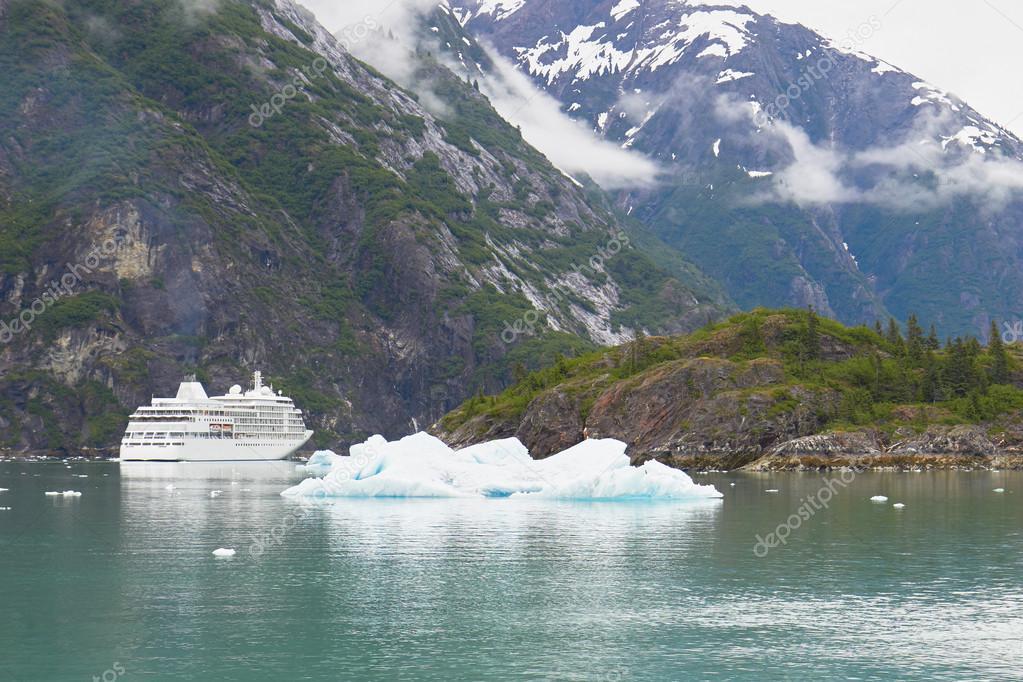 Alaska Cruise Ship with Iceberg and Mountain Landscape