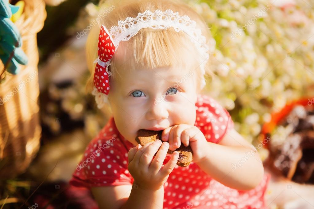 little girl eats chocolate cookies