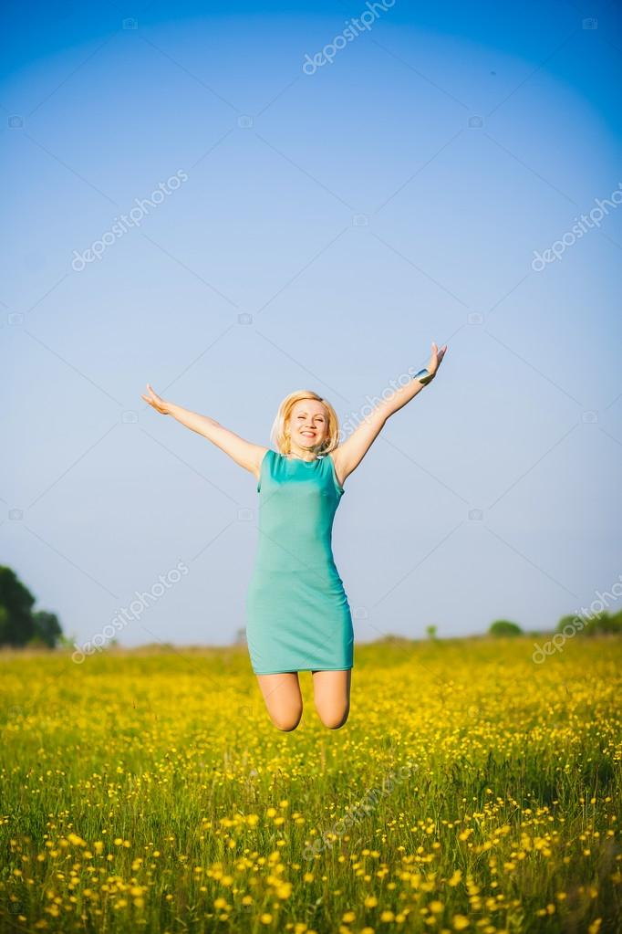 Lady having fun in spring or summer meadow