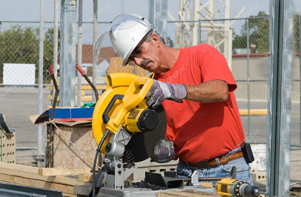 Worker changing saw blade stock photo lawcain 66440133 construction worker changing circular saw blade photo by lawcain greentooth Images