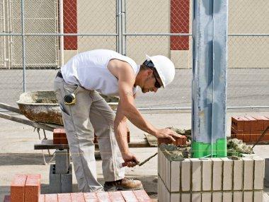 Bricklayer Laying Bricks