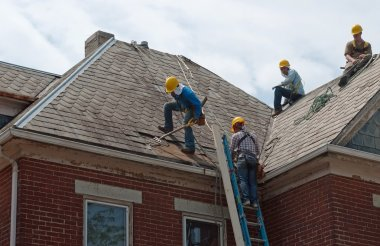 Immigrant Workers Removing Slate
