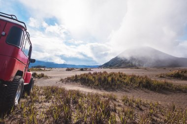 Red off road car at Mount Bromo, Indonesia, adventure trial