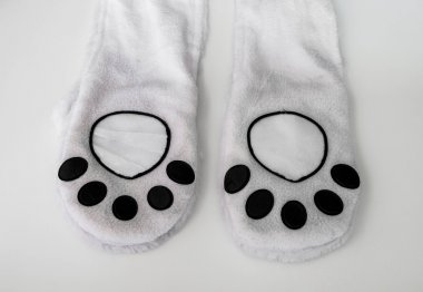 animal paw, part of clothes