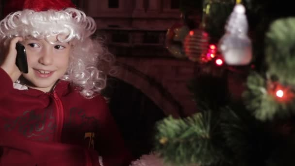 Malý chlapec Santa mluvit o telefonu
