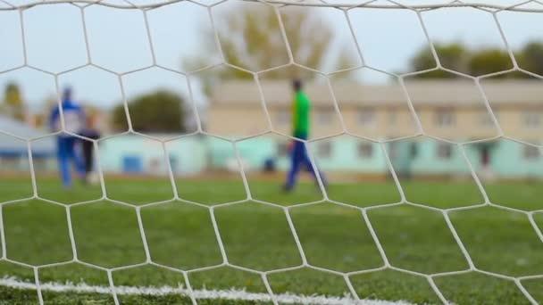 fotbalový cíl sítě, fotbal v pozadí