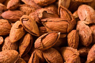 Delicious roasted sweet almonds nuts  background