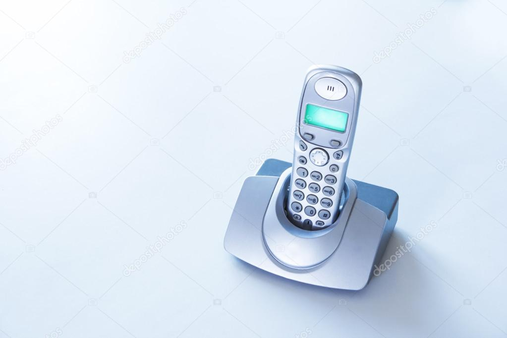 Cordless phone on a white table