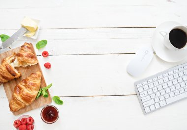 croissants and coffee at workplace
