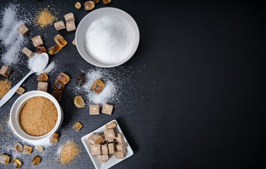 different types of sugar on black table