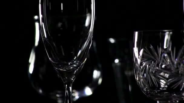 Glasses on black background. The camera motion in a circle 3