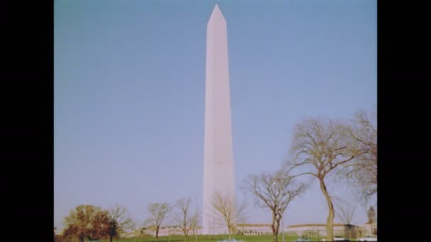 1960s: US flags fly at half-mast at base of Washington Monument. Film identification card reads : Roll N-3, Proj No 1-65/434, Title President Kennedy, Name Wash DC Natale, 365th Photographic Sq.