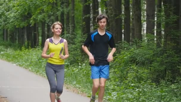 Couples take vacations jogging in the forest, slowmotion