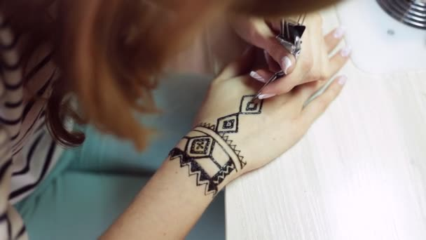 Henna tattoo on women hands