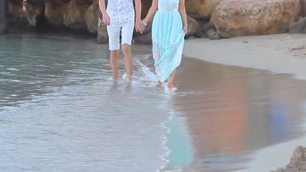 Beach couple walking on romantic travel honeymoon