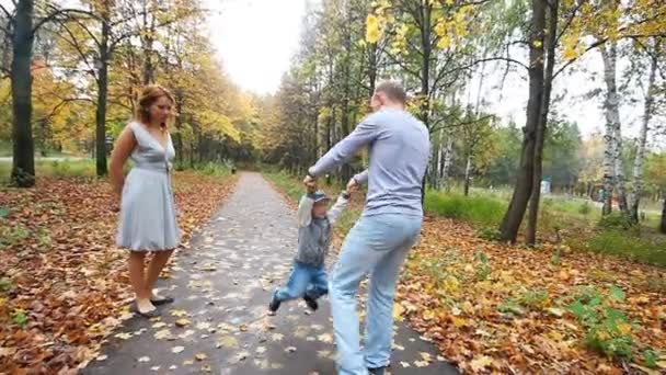Happy smiling family walk in autumn park