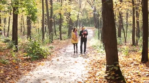 Happy family on walk in park in the autumn