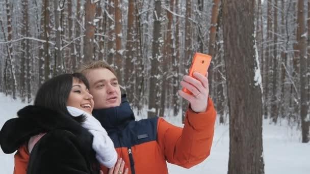 Happy couple taking selfie in slowmotion