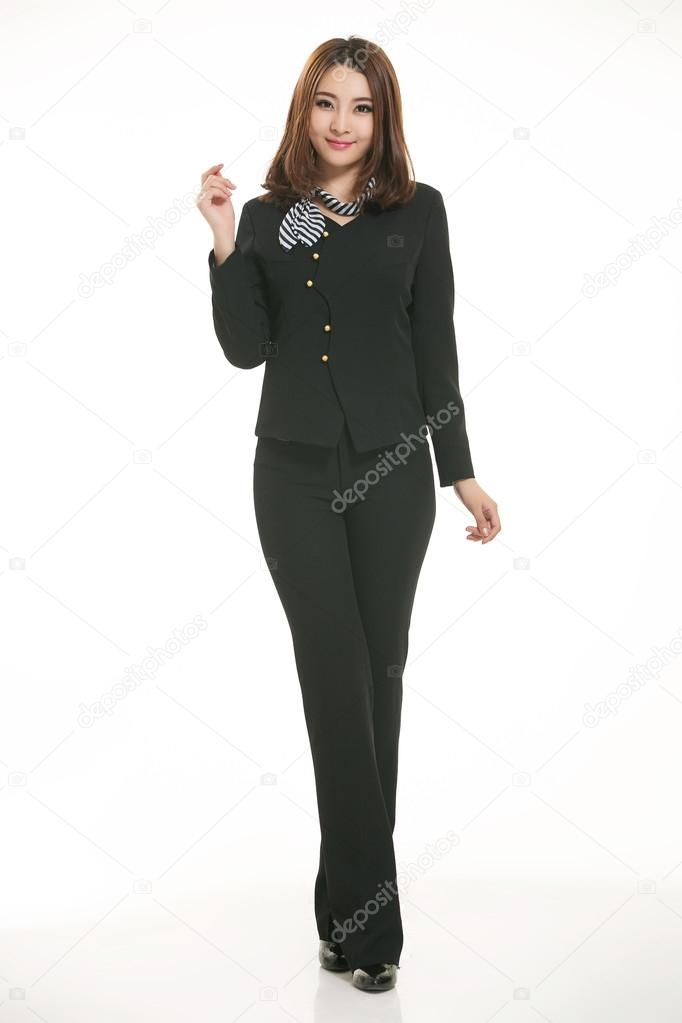Young Asian women wearing a suit in front of a white ...